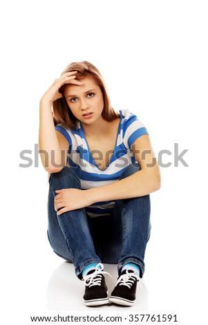 Teenage depression woman sitting on the floor. - stock photo