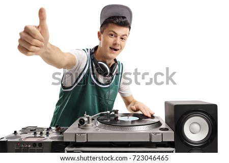Teenage DJ playing music on a turntable and making a thumb up sign isolated on white background