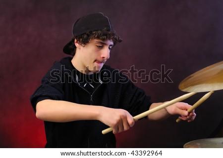Teenage drummer - stock photo