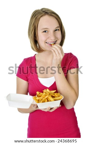 Teenage eating french fries isolated on white background