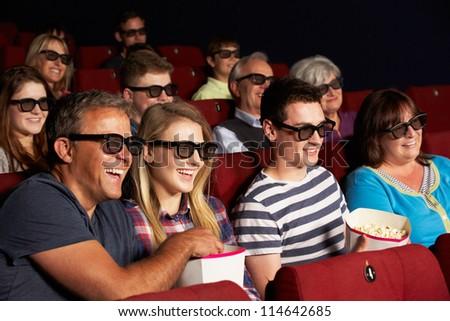 Teenage Family Watching 3D Film In Cinema - stock photo