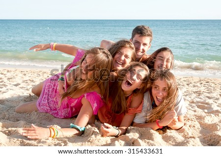 teenage friends at the beach