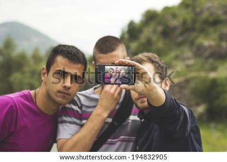 Teenage Friends Taking Selfie at Park - stock photo