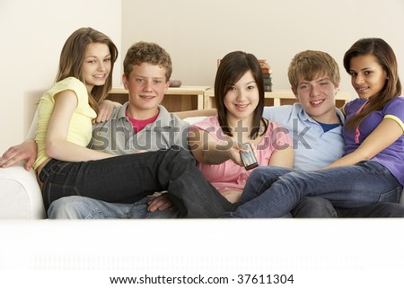 Teenage Friends Watching Television at Home - stock photo