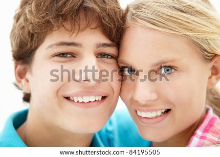 Teenage girl and boy head and shoulders - stock photo