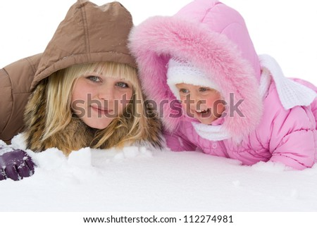 Teenage girl and  little girl in the snow - stock photo