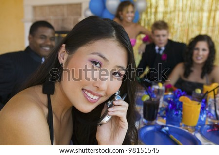 Teenage Girl at Party Using Cell Phone - stock photo
