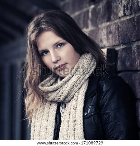 Teenage girl at the brick wall - stock photo
