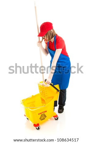 Teenage girl at work, using a mop and bucket.  Full body isolated on white.
