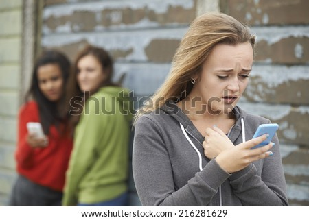 Teenage Girl Being Bullied By Text Message - stock photo