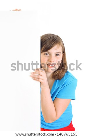 Teenage girl beside a white blank. - stock photo