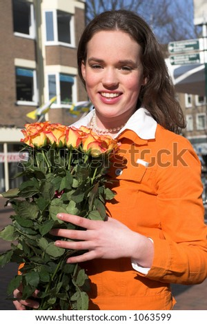 Teenage girl buying a lovely bouquet of roses