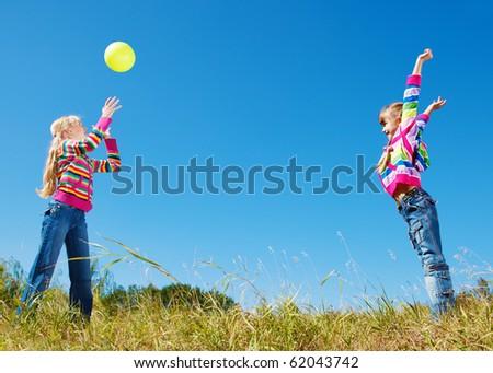 Teenage girl catching the ball - stock photo