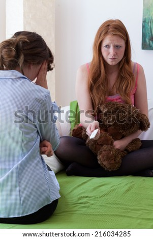 Teenage girl confess her mother to pregnancy - stock photo