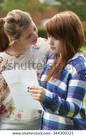 Teenage Girl Consoles Friend Over Bad Exam Result - stock photo