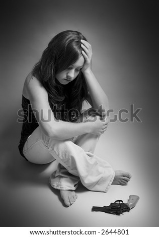 teenage girl contemplating suicide - stock photo
