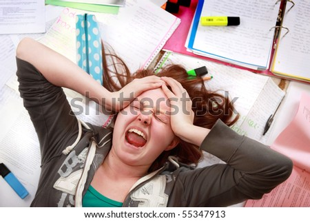 Teenage girl cracking under the pressure of exam revision stress - stock photo