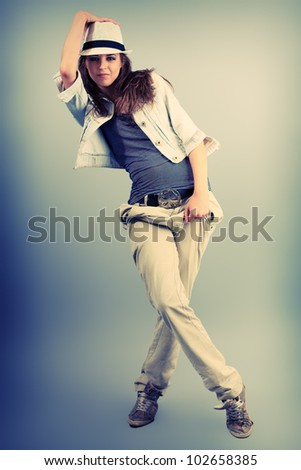 Teenage girl dancing hip-hop at studio. - stock photo