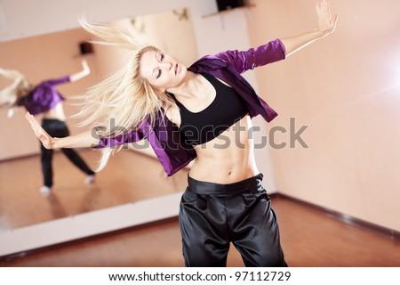 Teenage girl dancing hip-hop in gym classroom - stock photo