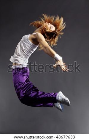Teenage girl dancing hip-hop studio series - stock photo
