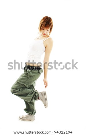 Teenage girl dancing hip-hop studio series. Isolated on white background - stock photo