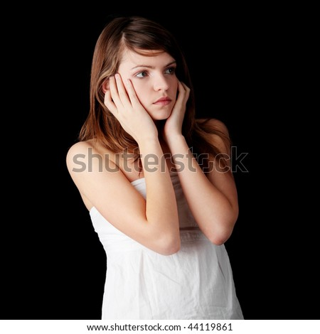 Teenage girl depression - lost love, teen problems - isolated on black background - stock photo