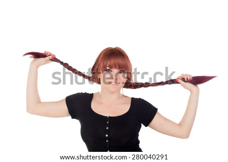 Teenage girl dressed in black with a piercing holding her braids isolated on white background - stock photo