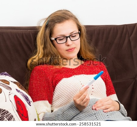 Teenage girl facing serious problem, being pregnant. - stock photo