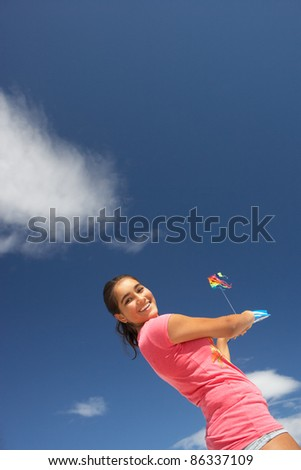 Teenage girl flying a kite