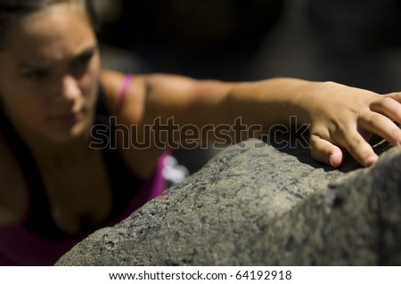 Teenage girl free rock climbing in summer - stock photo