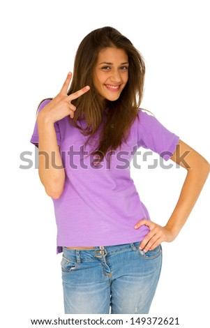 teenage girl giving peace sign - stock photo