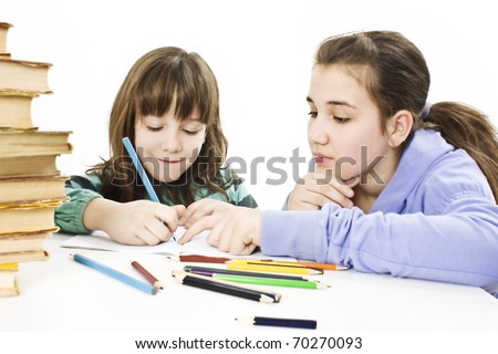 Teenage girl helping his sister with her homework - stock photo