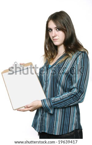 Teenage Girl holding a clipboard showing the Blank White Sheet. - stock photo