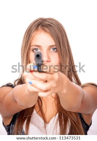 Teenage girl holding a gun, isolated on white - focus on the eyes and blurred gun - stock photo