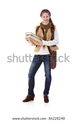 Teenage girl holding books, going to school.?