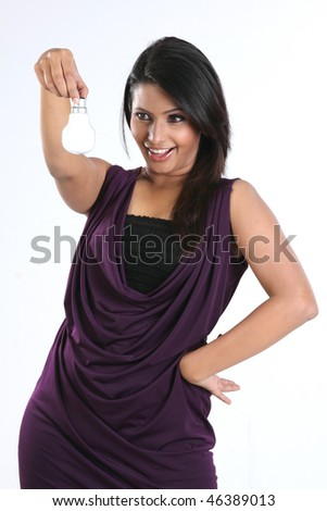 Teenage girl holding electric bulb - stock photo