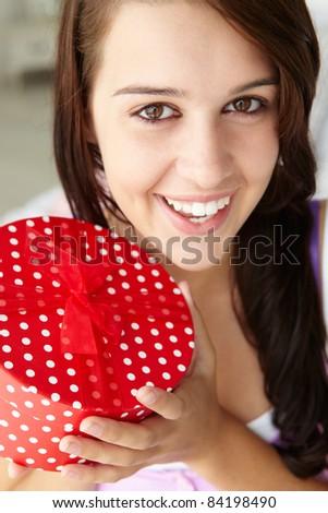 Teenage girl holding gift box - stock photo