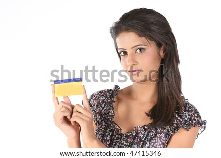 Teenage girl holding gold card - stock photo