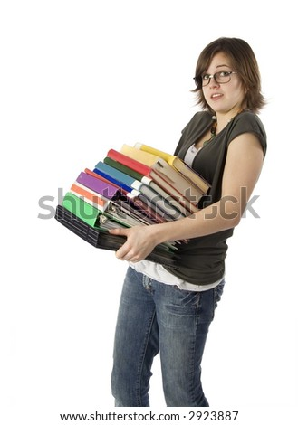 teenage girl holding large stack of books - stock photo