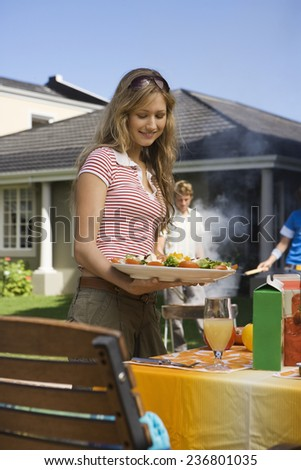 Teenage Girl Holding Salad Plate - stock photo