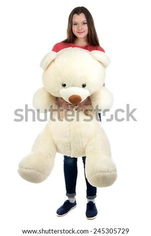 Teenage girl holding teddy bear on white background in full lenght - stock photo
