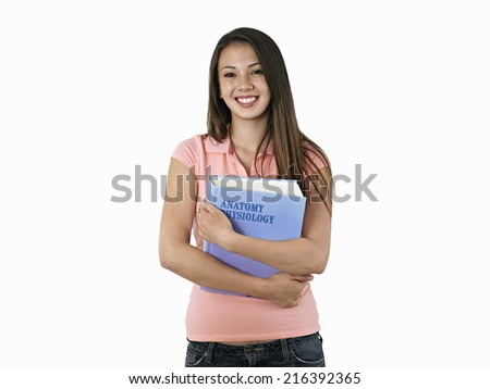 Teenage girl holding textbook, smiling, portrait, cut out