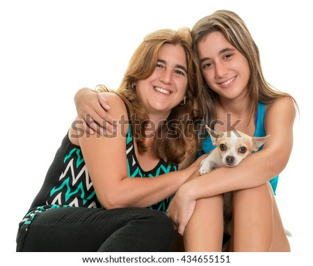 Teenage girl hugging her mother and their little chihuahua dog - Isolated on a white background - stock photo