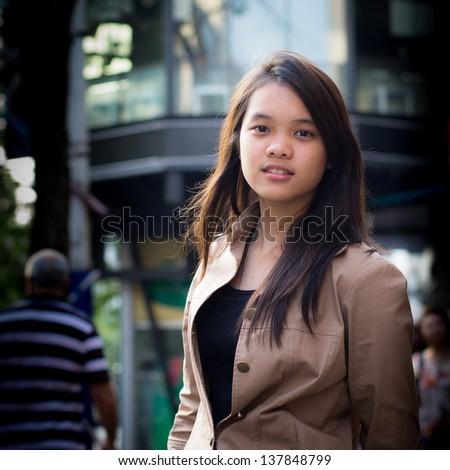 Teenage girl in downtown - stock photo