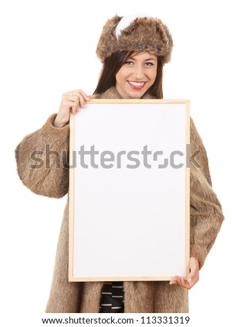 teenage girl in fur clothes with blank board, white background - stock photo