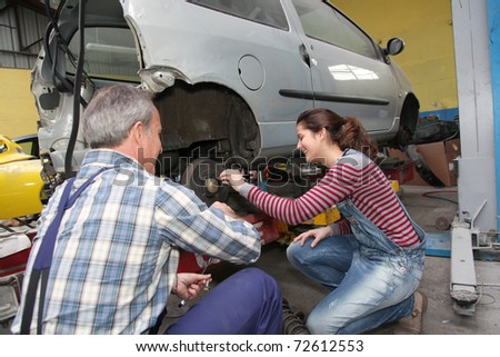 Teenage girl in professional training in workshop - stock photo