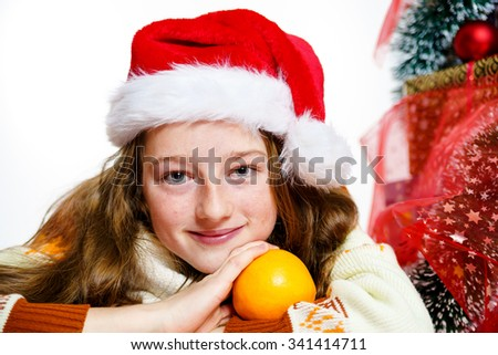 Teenage girl in red santa hat christmas portrait, isolated on white