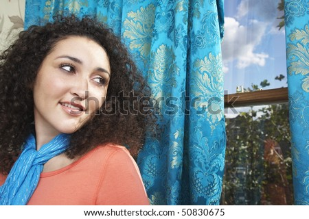 Teenage Girl in scarf,  looking over shoulder out window