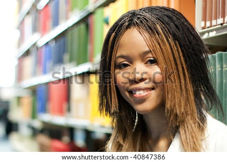 Teenage girl in the library - stock photo