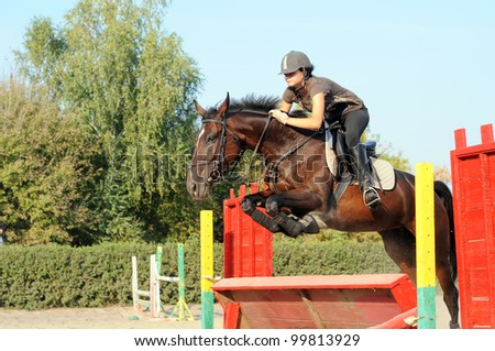 teenage girl in the training before jumping show